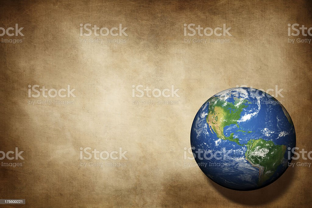 Earth globe on aged paper texture background royalty-free stock photo