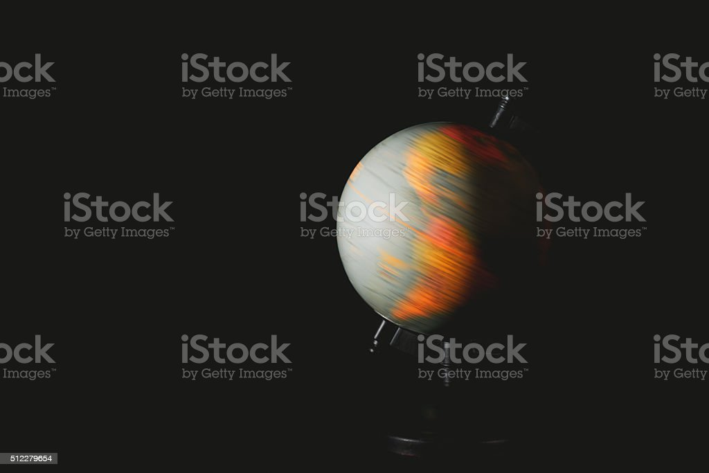 Earth globe spinning on black background stock photo