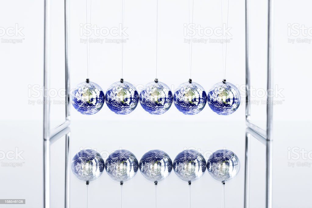 Earth Globes as Newton's Cradle stock photo