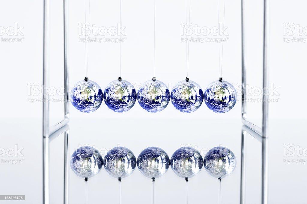 Earth Globes as Newton's Cradle stock photo