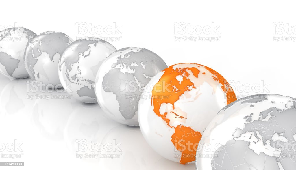Earth globes on white surface stock photo