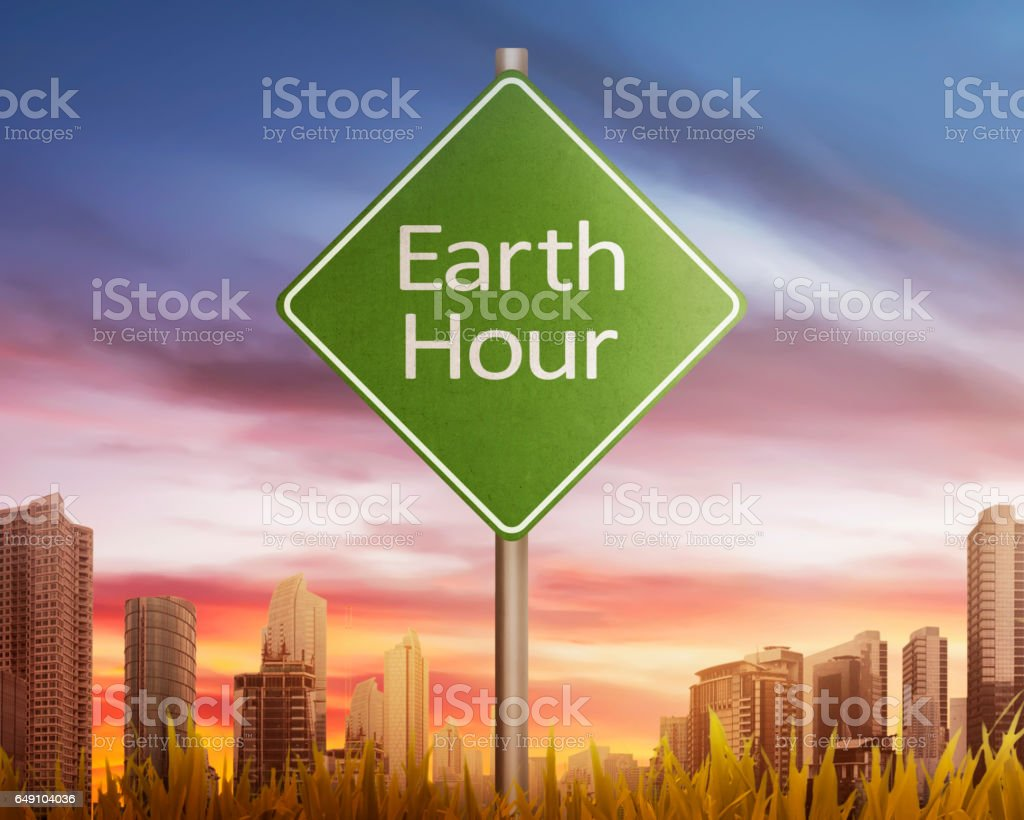 Earth Hour greeting on traffic sign at sunset stock photo