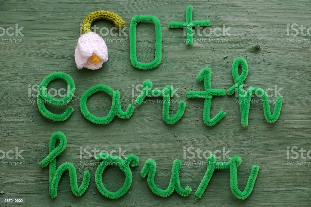 Earth hour message on green background stock photo