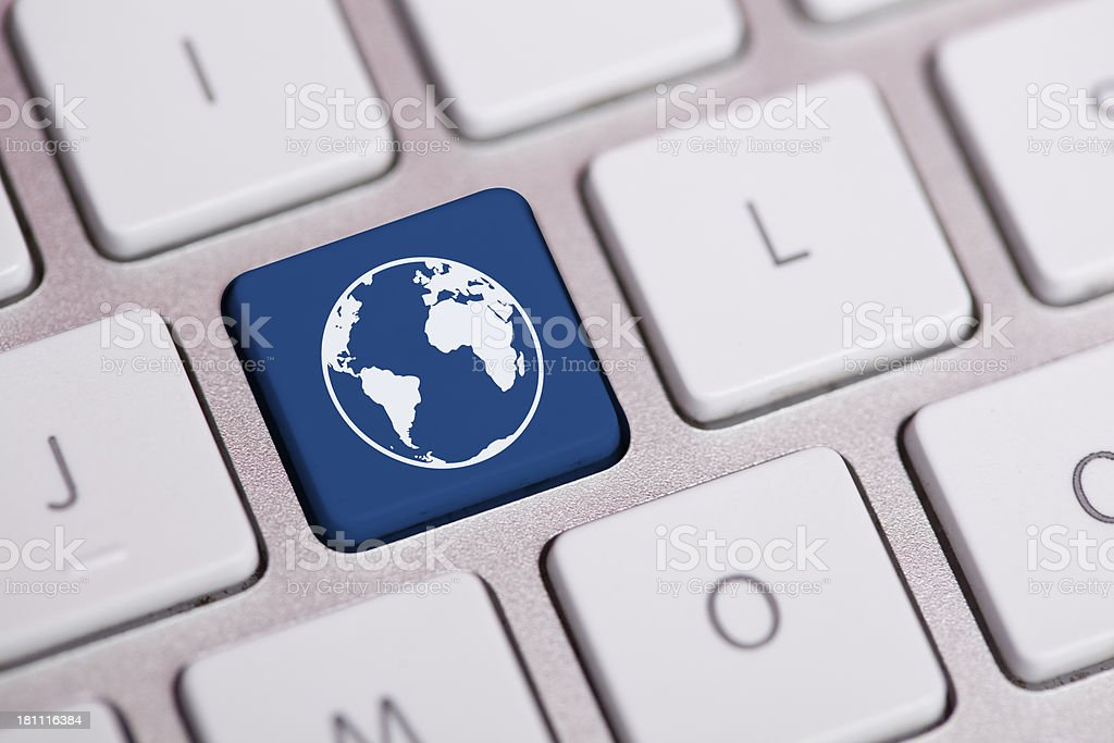 Earth icon on a keyboard button royalty-free stock photo