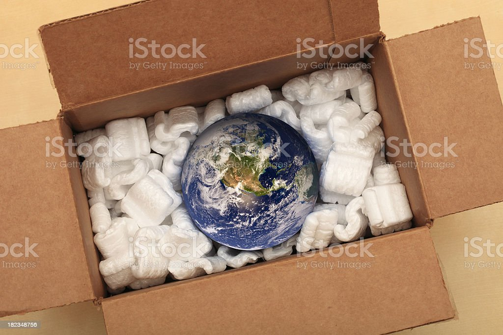 Earth in a box - Worldwide shipping solutions stock photo