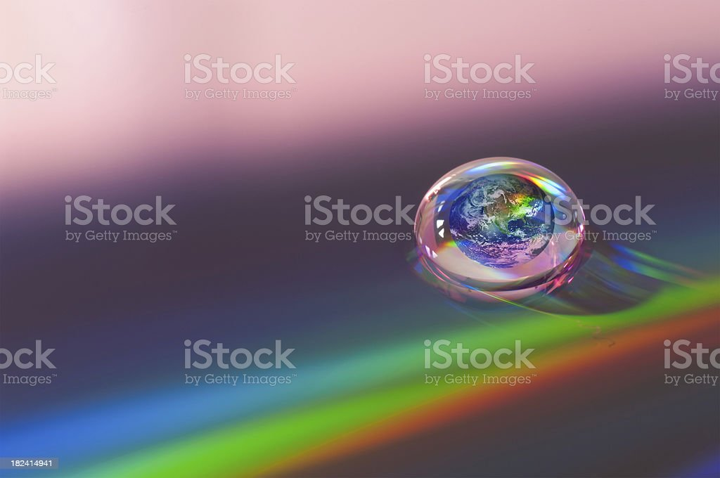 Earth in a droplet royalty-free stock photo