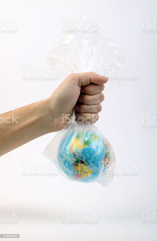 Earth  in a trash bag stock photo