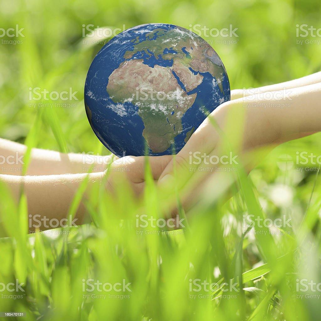Earth in children`s hands stock photo