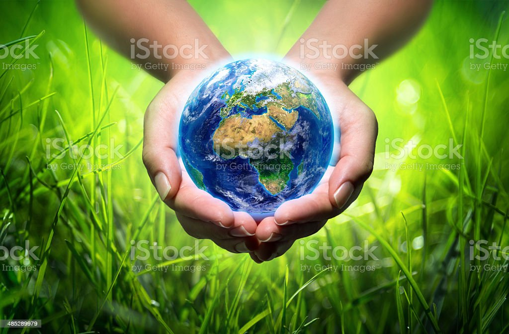 earth in hands - environment concept stock photo