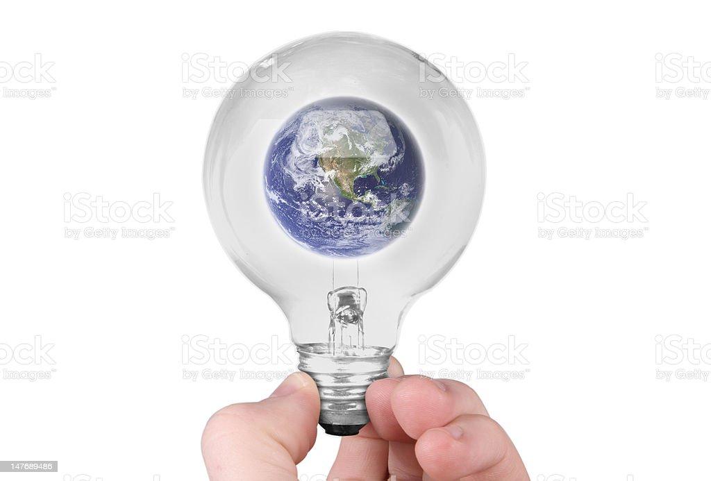 Earth in light bulb stock photo