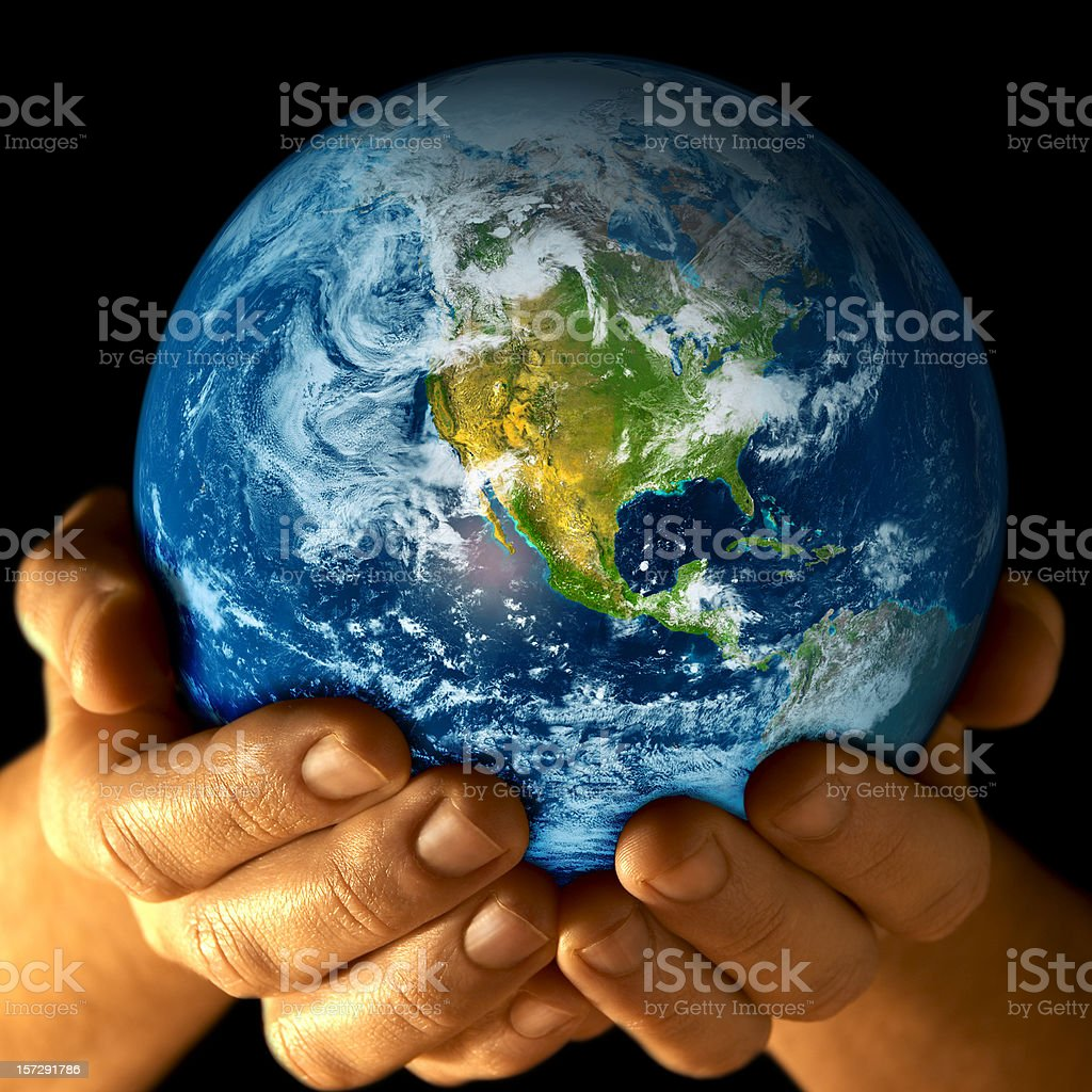 Earth in my hands - 2 stock photo