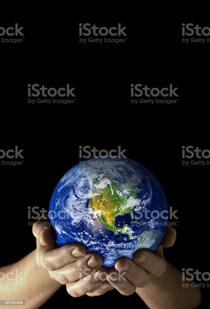 Earth in my hands -4 (tint) royalty-free stock photo