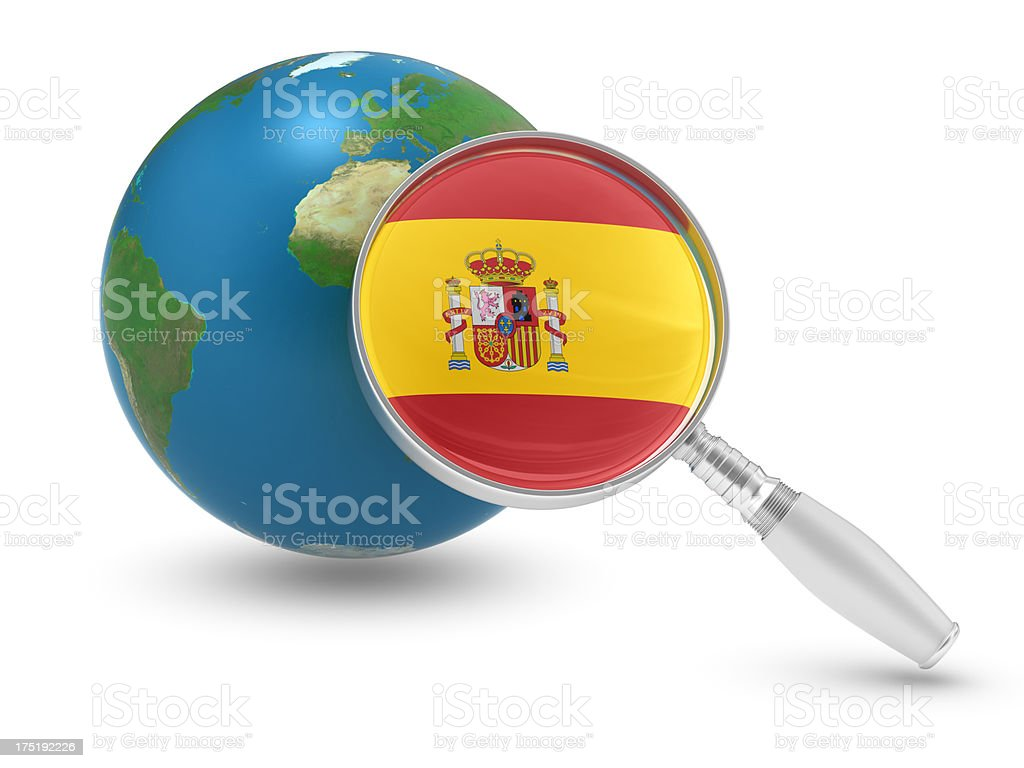 Earth Model and Magnifying with Spanish Flag royalty-free stock photo