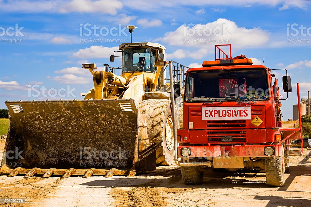 Earth Mover and Explosives truck at a Cement Plant England royalty-free stock photo