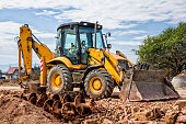 Earth Mover at improving the old road