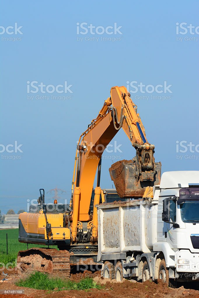 Earth Mover filling a truck stock photo