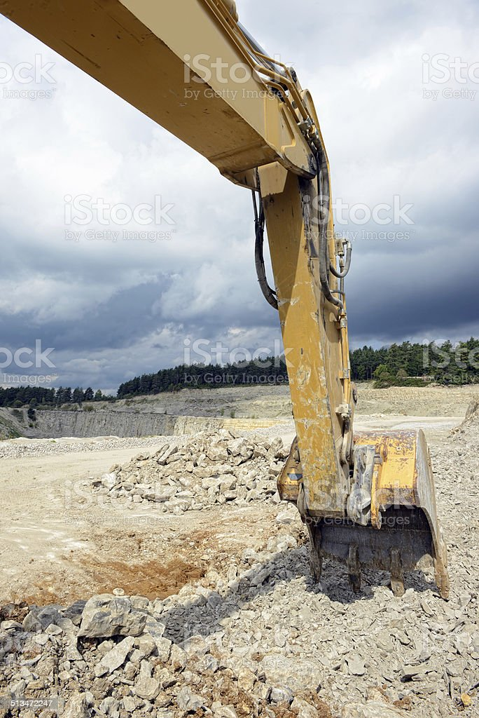 earth mover in limestone surface mine stock photo