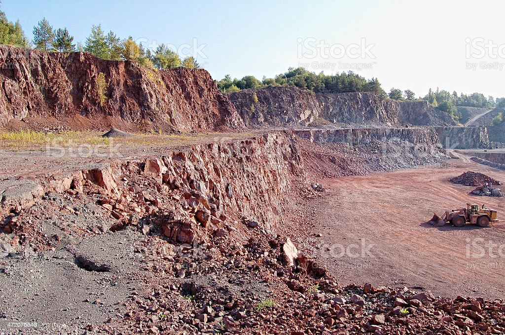 earth mover in surface mine quarry stock photo
