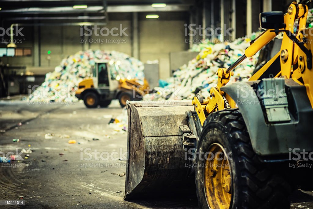 Earth mover in the garbage dump stock photo