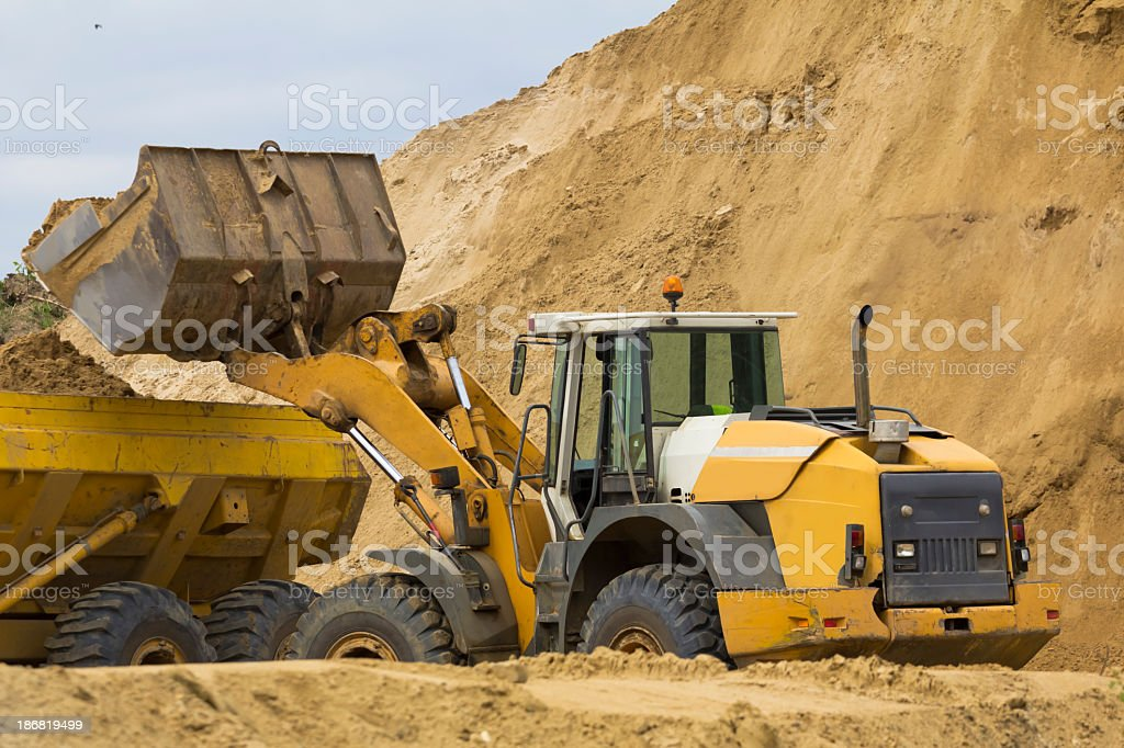 Earth Mover loading ground to the dump truck royalty-free stock photo