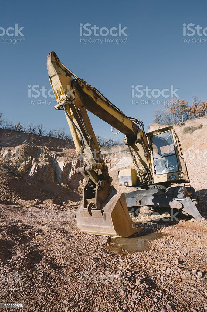 Earth mover on stone quarry stock photo
