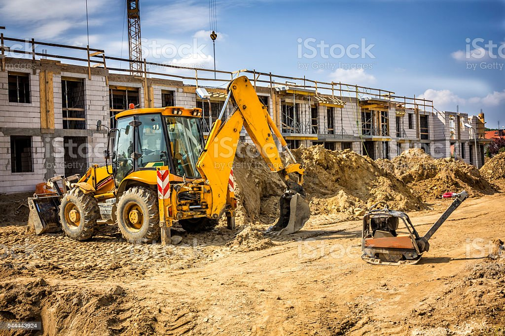 Earth Mover working on housing estate under construction stock photo
