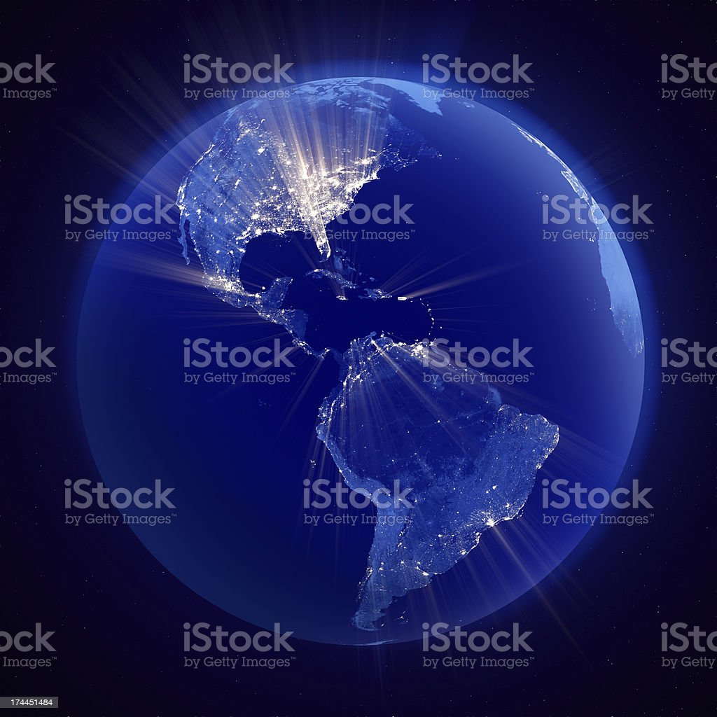 Earth nightlights emitting rays of light, Americas in focus stock photo