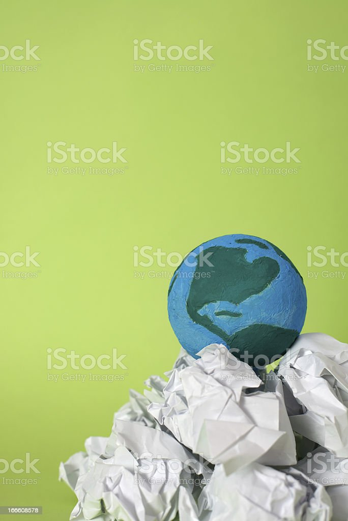 Earth on rubbish mountain royalty-free stock photo