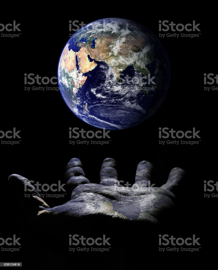 Earth over open hand stock photo