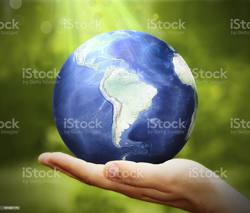 Earth Planet in Hand royalty-free stock photo