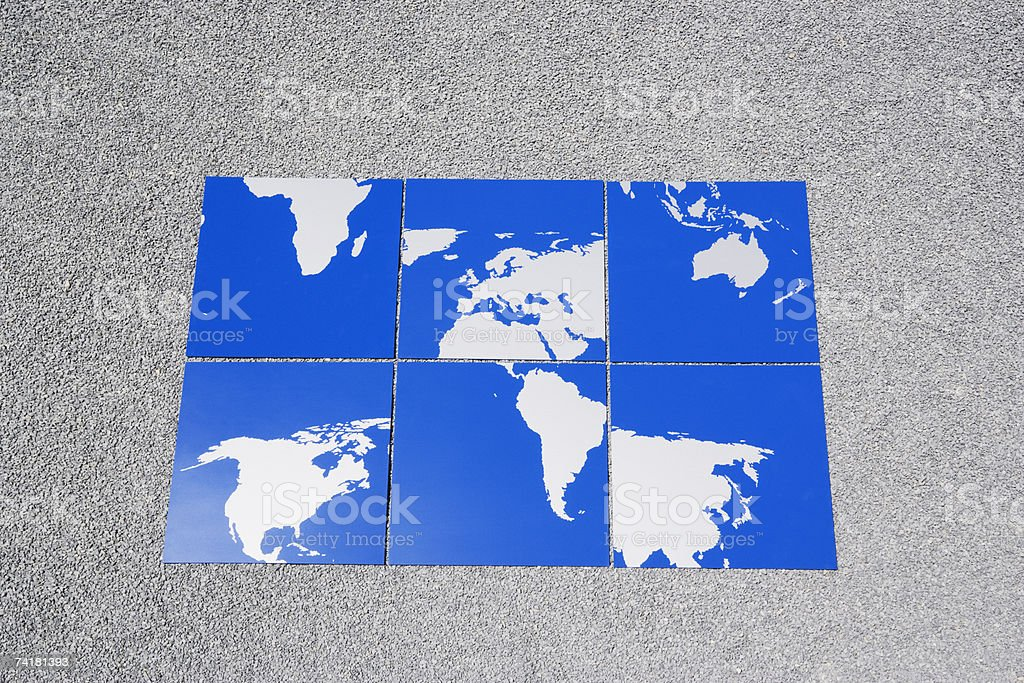 Earth puzzle on sand outdoors out of order royalty-free stock photo