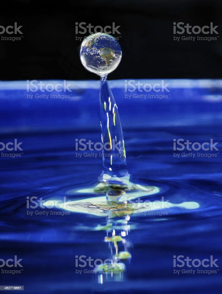 Earth raising from deep blue water stock photo