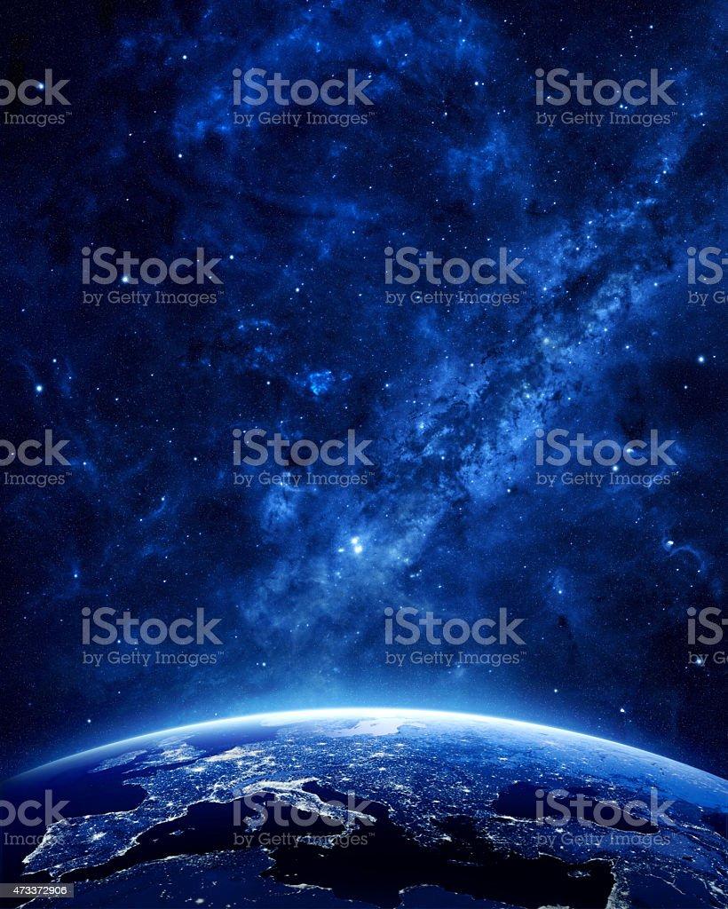 Earth, sky, and stars at night stock photo