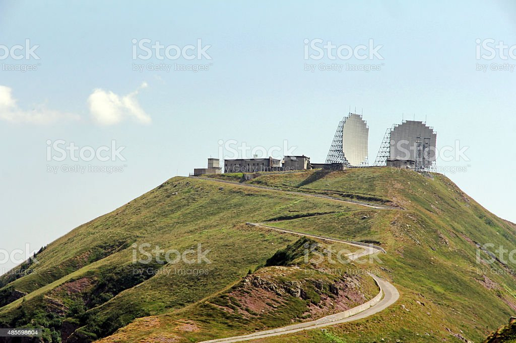 Earth station with satellite dishes stock photo