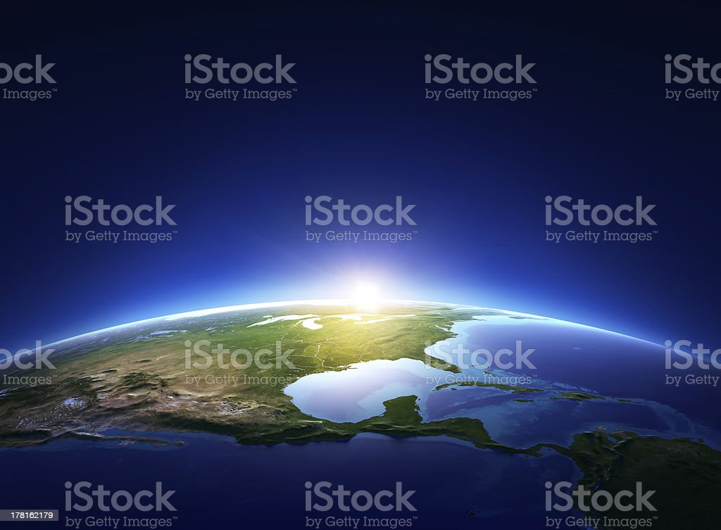 Earth sunrise over cloudless North America stock photo
