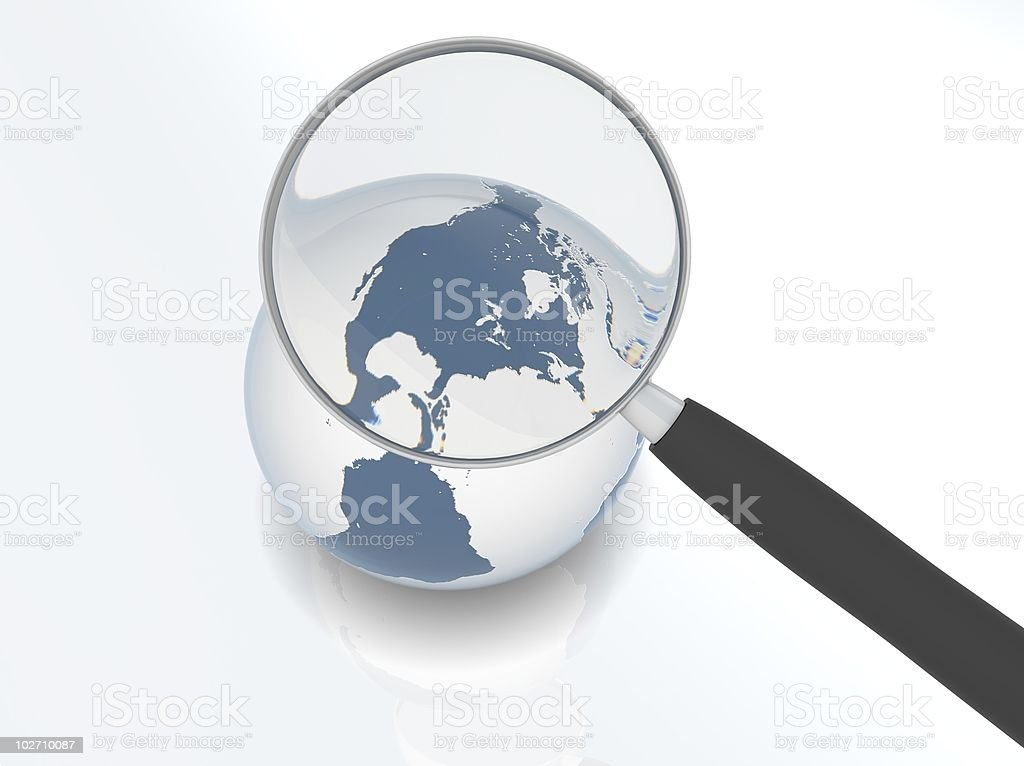 Earth under magnifier stock photo