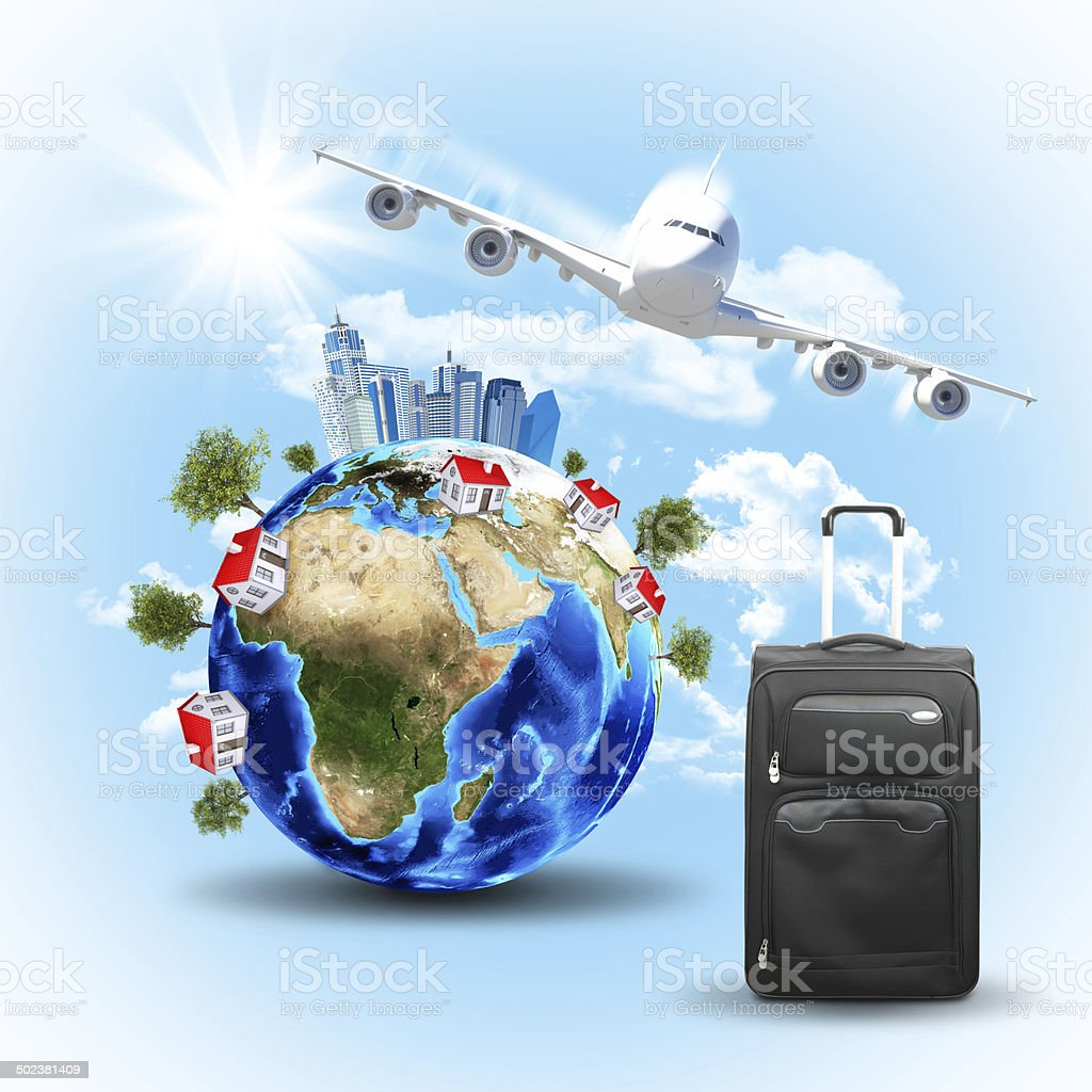 Earth with buildings, airplane and voyage bag stock photo