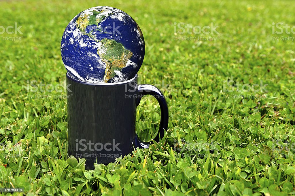 Earth World in a cup on grass stock photo