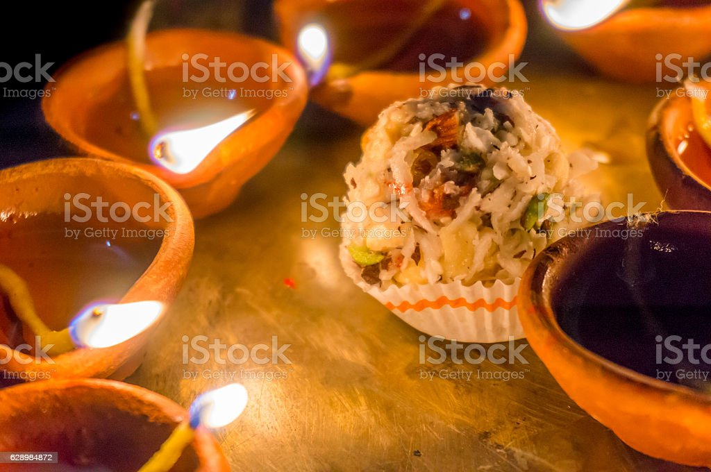 Earthen ware pots with cotton and oil to light stock photo