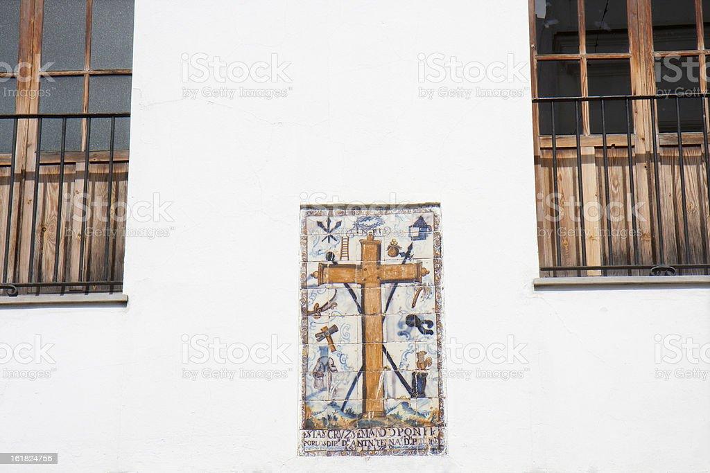 Earthenware cross on a facade royalty-free stock photo