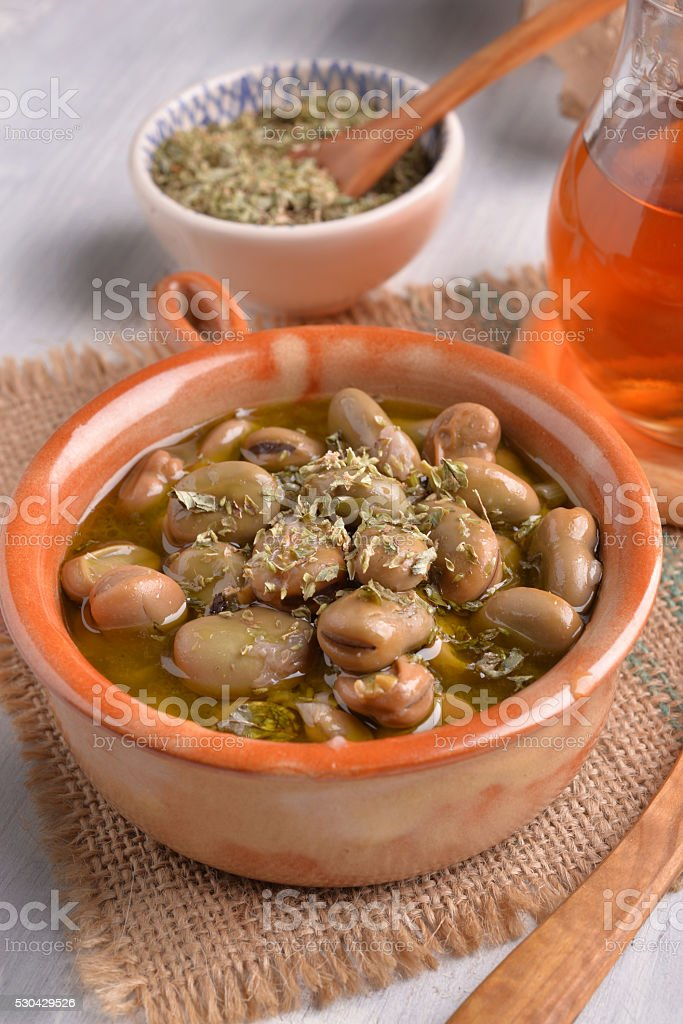 earthenware dish with fava beans olive oil and oregano stock photo