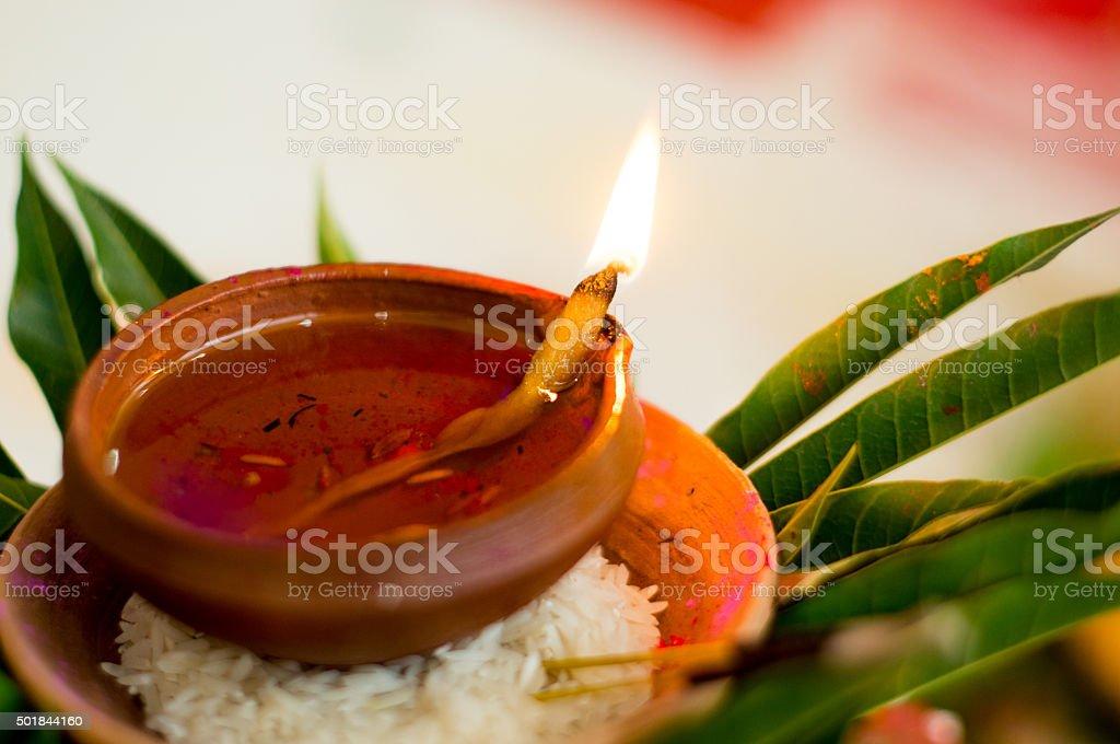 Earthenware lamp in hindu ritual stock photo