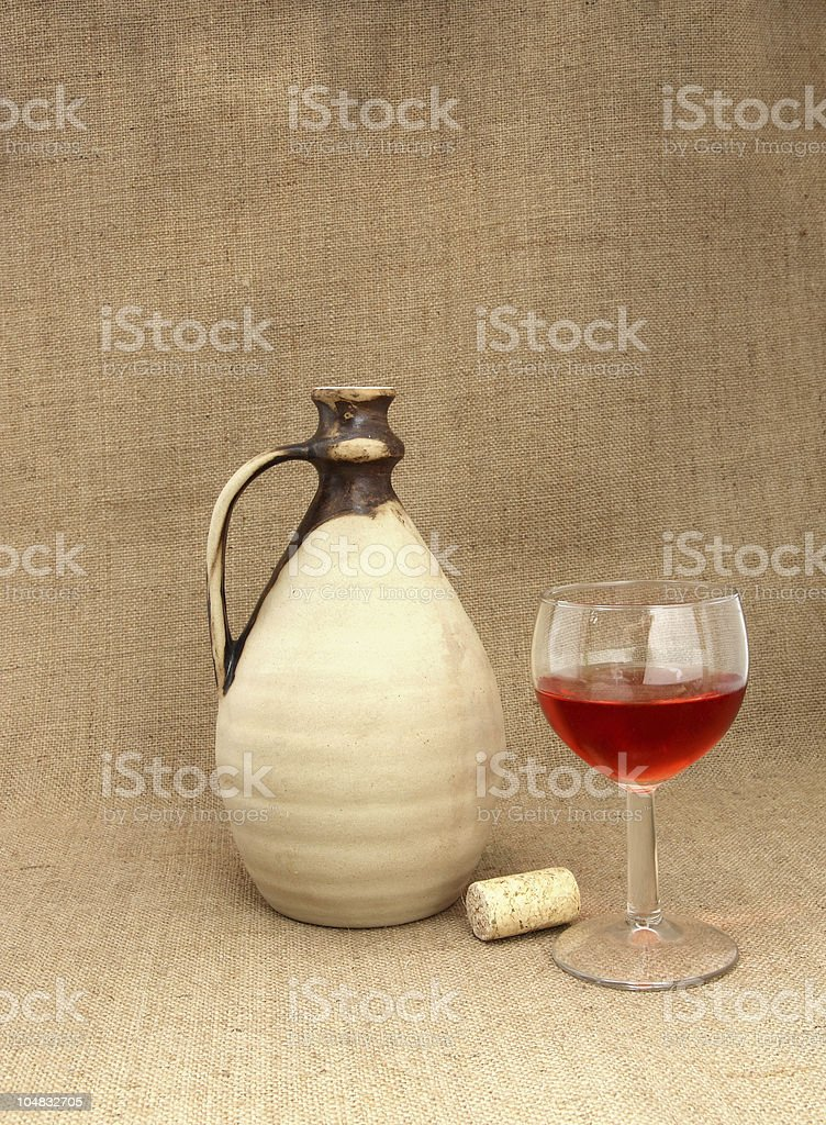 Earthenware pitcher and wineglass royalty-free stock photo