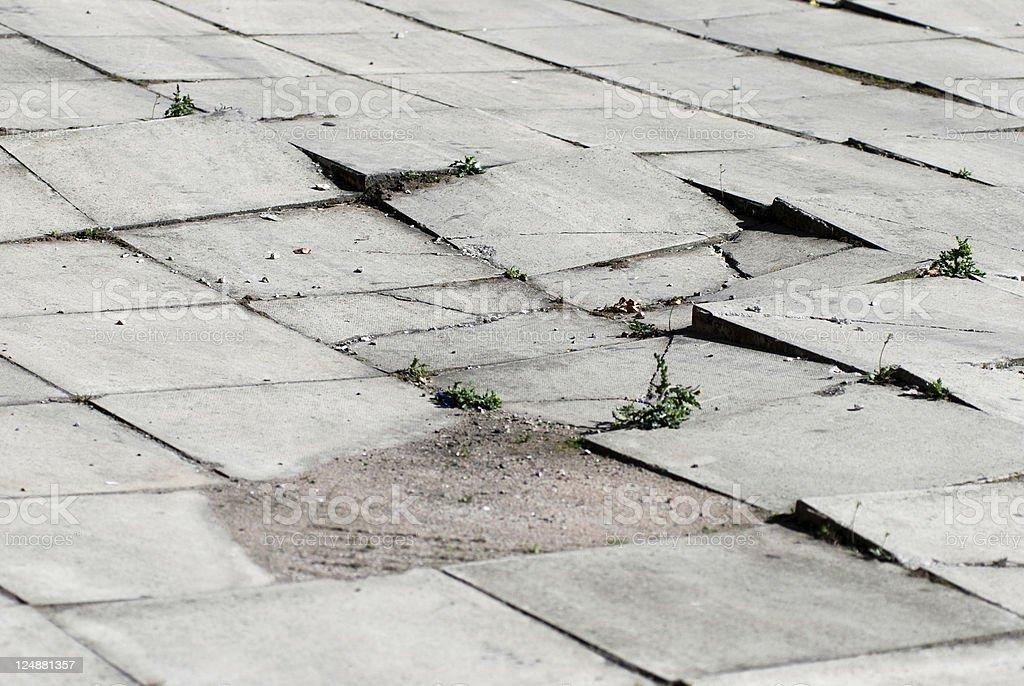 Earthquake effects on sidewalk royalty-free stock photo
