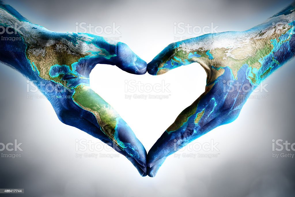 earth's day celebration - hands shaped heart with world map stock photo
