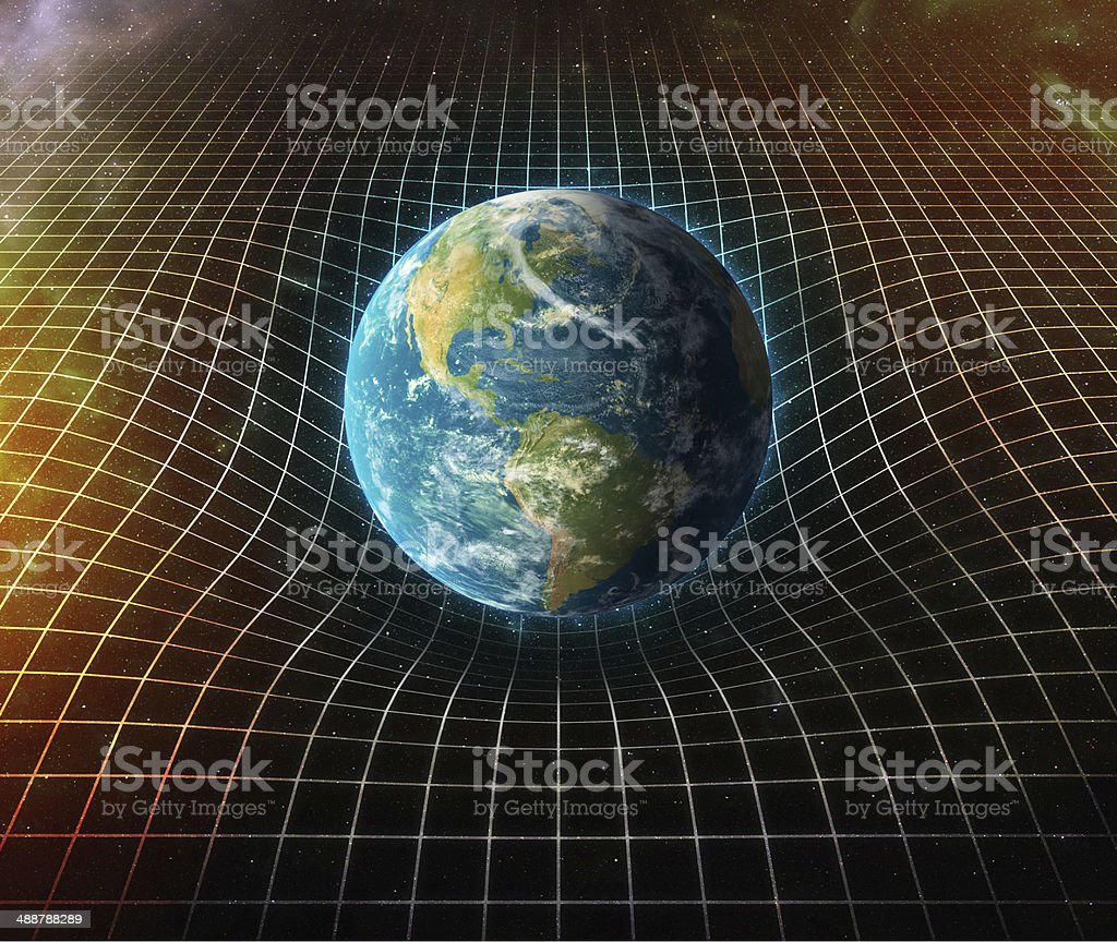 earth's gravity bends space around it stock photo