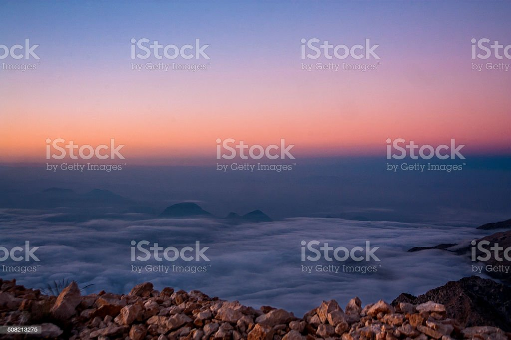 Earth's Shadow above the clouds stock photo
