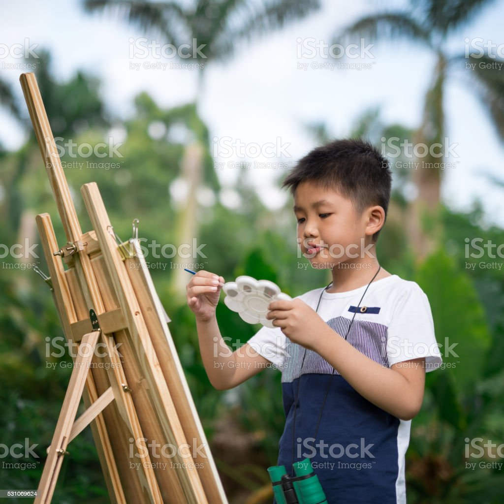 Easel and children stock photo