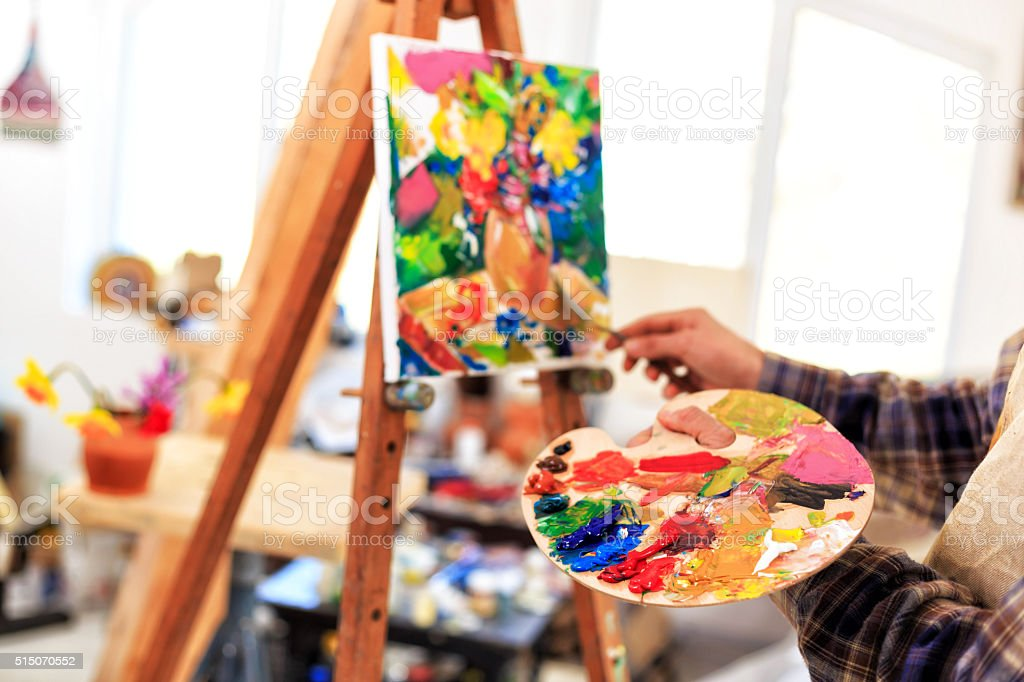 Easel and palette stock photo