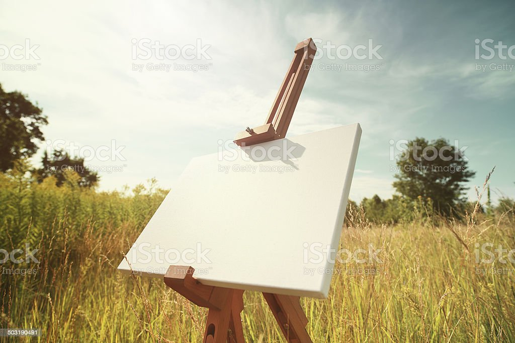 Easel in field stock photo